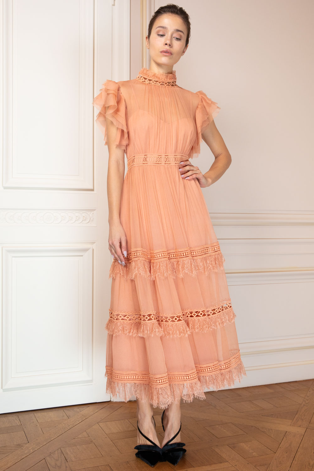 Apricot tea gown with ruffled collar and sleeves, openwork lace and fringed tiers