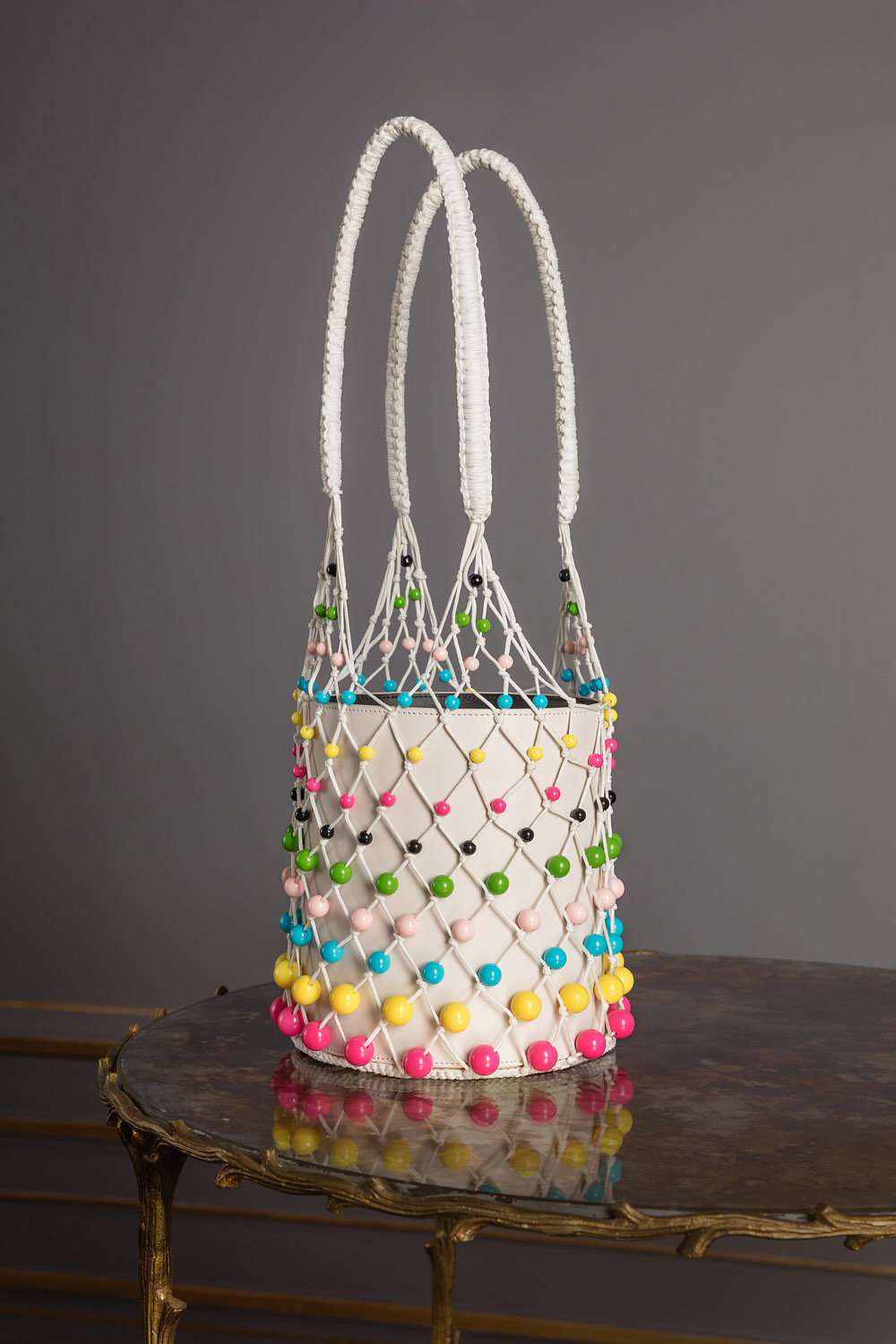 Goat leather bag in sugar white with white netting and bubble-gum colored beads