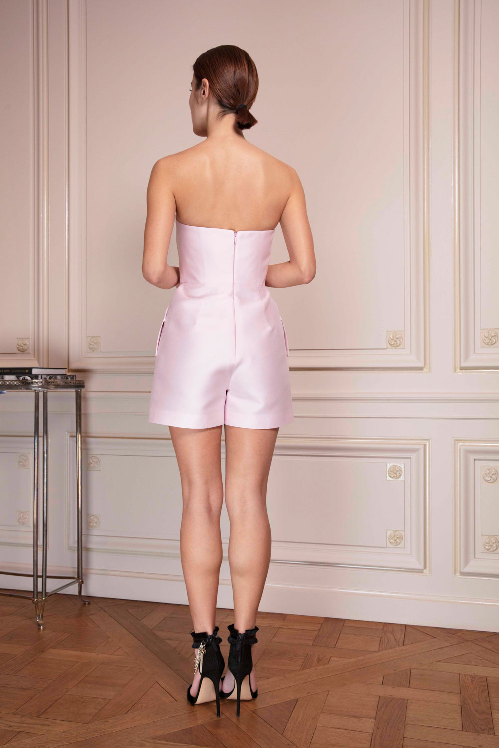 Pale pink bustier shorts jumpsuit with bow